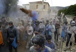 """The flour smudging or """"flour war"""" during the celebration of Clean Monday in the greek Carnival, at the port town of Galaxidi, some 200 km west of Athens. On March 18, 2013 / Αλευρομουτζουρώματα στην κωμόπολη του Γαλαξειδίου, στο νομό Φωκίδας την Καθαρά Δευτέρα."""